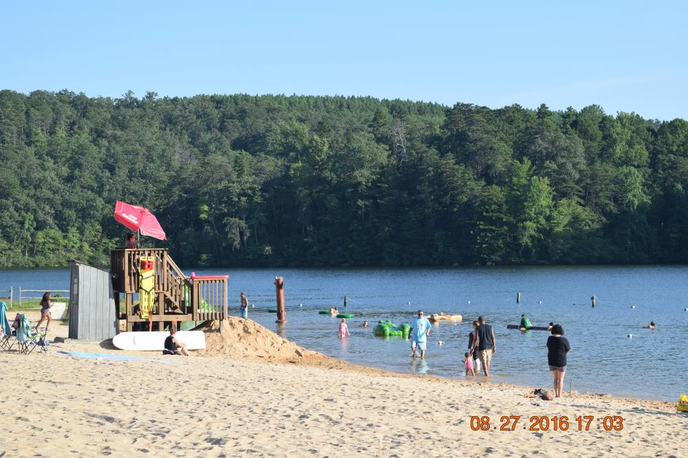 Photo of people enjoying time at the beach at Holliday Lake State Park