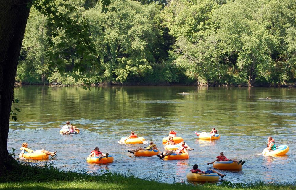 Photo of people floating the river in brightly colored tubes at James River State Park
